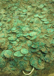 The excavated hoard . Two gold torcs have been identified at the edge of the mass of coins