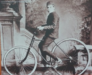 Dunlop's son Johnny on the first bicycle to have pneumatic tyres, 1888
