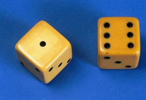A pair of dice made in imitation ivory celluloid from the early 20th Century