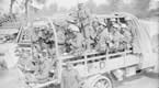 Battle of Guillemont. Men of the 16th Irish Division (probably of the 47th Brigade) in a lorry going back for a rest after taking Guillemont, 3 September 1916.