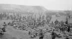 Men of the Royal Irish Regiment near Bertincourt awaiting orders to advance. 20th November 1917