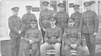 B Coy Sergts Dec 1918 in France. Standing Sgts Le Gallez, Martel, Archer, Couch, Hamelin, Jehan. Seated CSM H Heaume, Capt B Jones, CQMS W R Symons